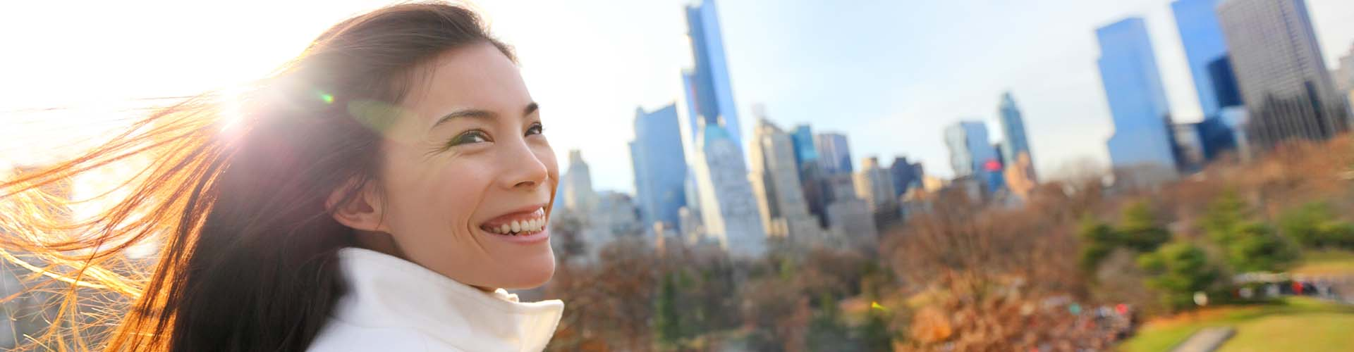 Woman smiling with city behind her